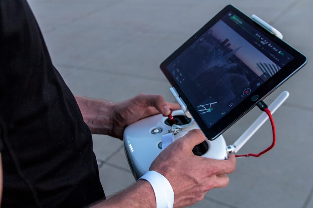 man-holding-drone-controller_web